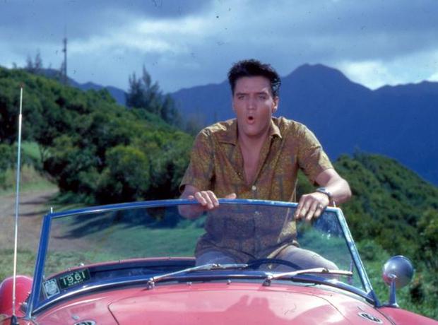 Elvis in sports car